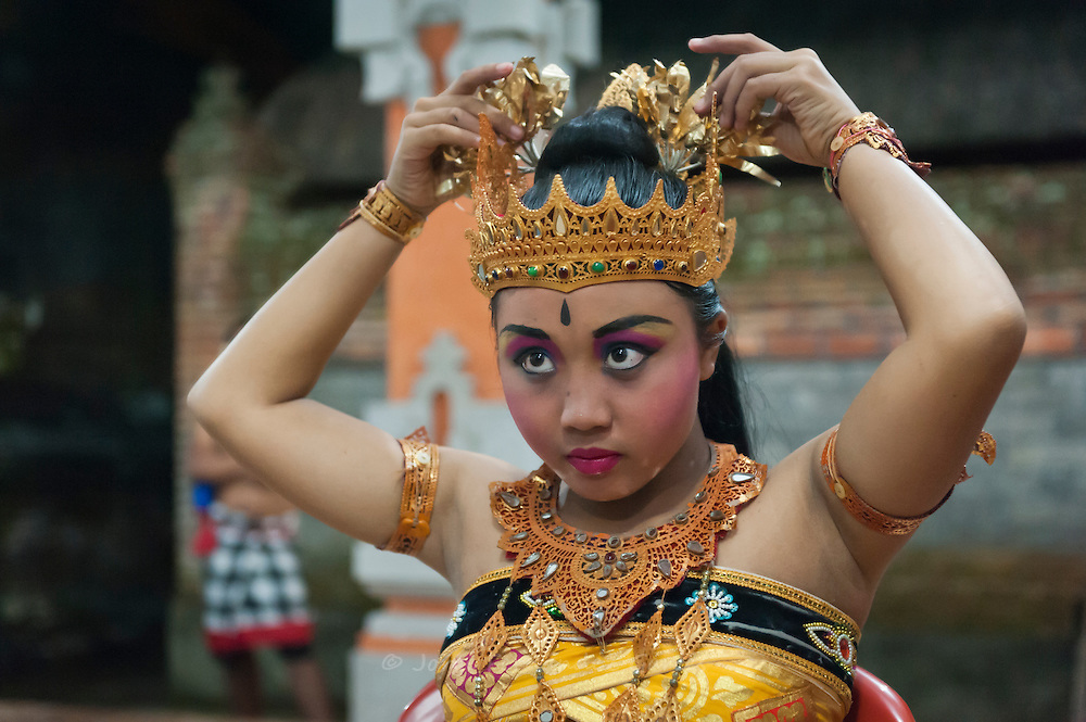 Member of Taman Kaja troup dressing up for a kecak show, a kind of Balinese dancing, in Pura Dalem, Ubud, Bali, Indonesia
