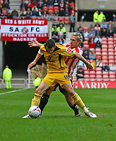 Photo: Andrew Unwin.<br />Sunderland v Barnsley. Coca Cola Championship. 21/10/2006.<br />Barnsley's Michael McIndoe (L) holds off Sunderland's Liam Lawrence (R).