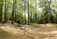"Riders cruise down the ""Freedom Trail"" at Highland Mountain Bike Park in Northfield on Wednesday afternoon.  (Karen Bobotas/for the Laconia Daily Sun)"