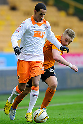 Blackpool Midfielder Thomas Ince (ENG) is challenged by Wolves Midfielder Jamie O'Hara (ENG) during the first half of the match - Photo mandatory by-line: Rogan Thomson/JMP - Tel: Mobile: 07966 386802 26/01/2013 - SPORT - FOOTBALL - Molineux Stadium - Wolverhampton. Wolverhampton Wonderers v Blackpool - npower Championship.