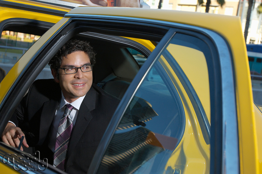 Businessman sitting in taxi
