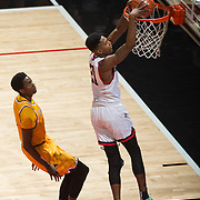 31 January 2017:  The San Diego State Aztecs men's basketball team hosts Wyoming Tuesday night at Viejas Arena. San Diego State forward Malik Pope (21) dunks the ball on a break away in the first half. The Aztecs lead the Cowboys 31-27 at half time. www.sdsuaztecphotos.com