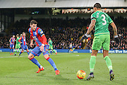 Sunderland defender Patrick Van Aanholt takes on Crystal Palace defender Joel Ward  during the Barclays Premier League match between Crystal Palace and Sunderland at Selhurst Park, London, England on 23 November 2015. Photo by Simon Davies.