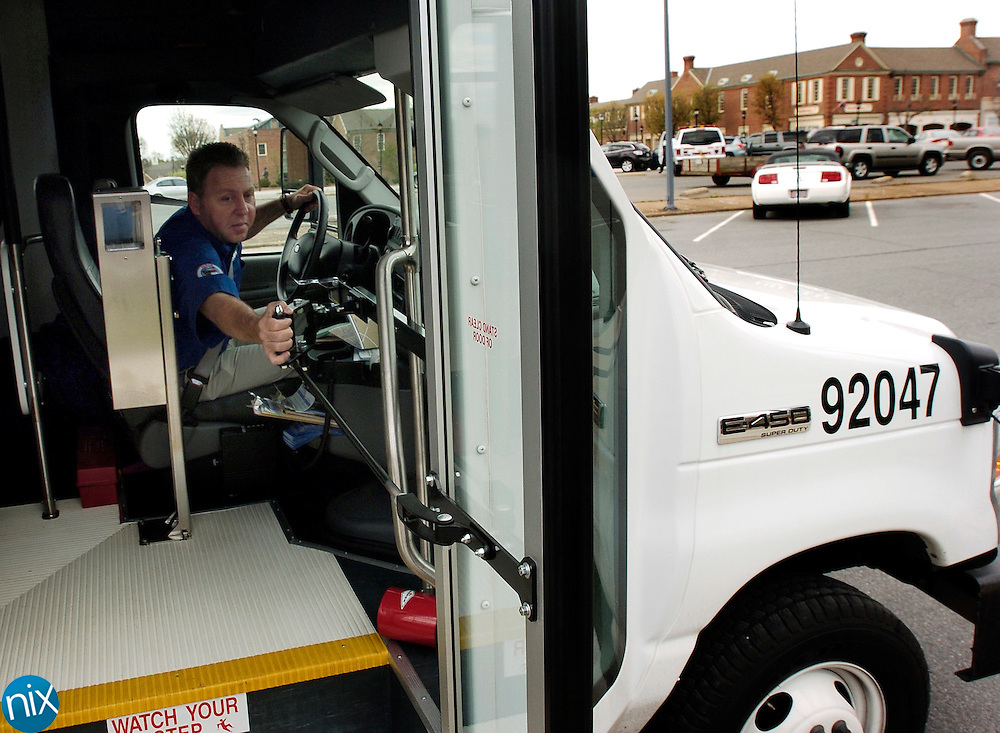 Rowan Express driver Jonathan Cooper closes the door on his bus before departing the Kannapolis Train Station on his way to Salisbury Monday afternoon. The Rowan Transit System service started Monday and will carry riders between Kannapolis and Salisbury eights times a day.