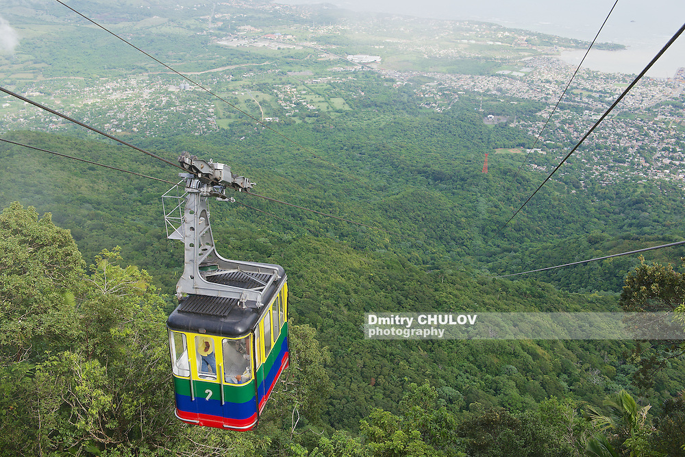 PURTO PLATA, DOMINICAN REPUBLIC - NOVEMBER 04, 2012: Unidentified tourists ride the cable car to the top of Pico Isabel de Torres. This aerial tramway is the only one in the Caribbean.