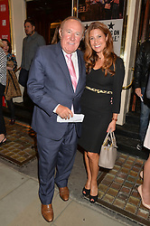 ANDREW NEIL and SUSAN NILSSON at the West End opening night of 'Great Britain' a  play by Richard Bean held at The Theatre Royal, Haymarket, London followed by a post show party at Mint Leaf, Suffolk Place, London on 26th September 2014.