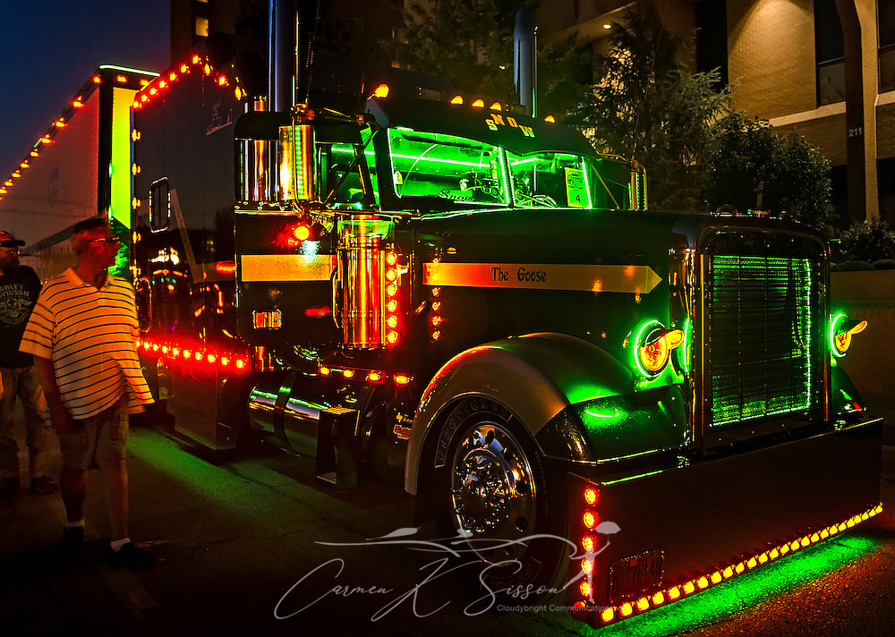 """Daniel and Phyllis Snow's 1996 Freightliner Classic XL, """"The Goose,"""" participates in the light show contest during the 34th annual Shell Rotella SuperRigs. SuperRigs, organized by Shell Oil Company, is an annual beauty contest for working trucks. Approximately 89 trucks entered this year's competition. (Photo by Carmen K. Sisson/Cloudybright)"""