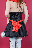 Back view torso of teenage girl in a dress over colored background