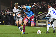 Colchester United player Harry Pell(8) and Scunthorpe United player Kevin van Veen (10) during the EFL Sky Bet League 2 match between Scunthorpe United and Colchester United at Glanford Park, Scunthorpe, England on 14 December 2019.