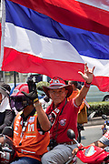 Apr. 12, 2010 - BANGKOK, THAILAND: Red Shirts call for the Thai government to step down during motorcade in Bangkok Monday. The funeral cortege for the Red Shirts killed in the violent crackdown Saturday wound through Bangkok Monday. Thousands of mourners came out to pay respects for dead Red Shirts. 21 people, including 16 Thai civilians were killed when soldiers tried to clear the Red Shirts' encampment in Bangkok. Thousands more came out to call for the government of Thai Prime Minister Abhisit Vejjajiva to step down. Today Gen. Anupong Paojinda, the Chief of Staff of the Thai Army, reiterated that the Army would not use violence to break up the protests and joined the call for the Prime Minister to call new elections. This is the beginning of Songkran, Thai New Year's week, and the government has cancelled the official festivities fearing more violence. It was during last year's Songkan festivities that the Thai Army and police used force to break up the Red Shirt protests. That protest is now called the Songkran Riots.     Photo By Jack Kurtz
