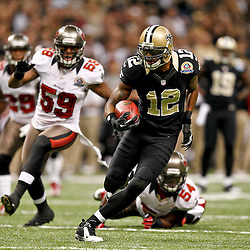 December 16, 2012; New Orleans, LA, USA; New Orleans Saints wide receiver Marques Colston (12) runs after a catch as Tampa Bay Buccaneers middle linebacker Mason Foster (59) and outside linebacker Lavonte David (54) pursue during the first half of a game at the Mercedes-Benz Superdome. The Saints defeated the Buccaneers 41-0. Mandatory Credit: Derick E. Hingle-USA TODAY Sports
