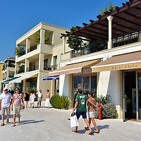 """Shopping Promenade in Tivat, Montenegro<br /> Proto Montenegro is fast redefining leisure along the Adriatic Sea coastline. This shopping promenade facing the marina and waterfront are just the beginning.  Eventually this exclusive community will offer eight restaurants, three bars, a yacht club, sports facilities, an 18-hole golf course plus an ice-cream parlor for those hot summer days. The """"Village"""" also hosts exclusive entertainment events."""