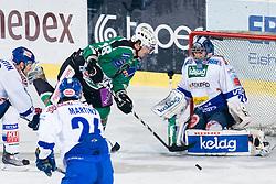 Jure Kralj (HDD Tilia Olimpija, #18) vs Bernhard Starkbaum (EC Rekord-Fenster VSV, #29) during ice-hockey match between HDD Tilia Olimpija and EC Rekord-Fenster VSV in 31st Round of EBEL league, on December 28, 2010 at Hala Tivoli, Ljubljana, Slovenia. (Photo By Matic Klansek Velej / Sportida.com)