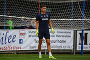 AFC Wimbledon goalkeeper Nikola Tzanev (25) warms up during the Pre-Season Friendly match between Hampton & Richmond and AFC Wimbledon at Beveree Stadium, Richmond Upon Thames, United Kingdom on 27 July 2019.