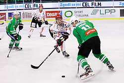 Ziga Pesut of Olimpija and Urban Sodja of Jesenice during ice hockey match between HDD Olimpija Ljubljana and HDD SIJ Acroni Jesenice in Final of Slovenian League 2016/17, on April 12, 2017 in Hala Tivoli, Ljubljana, Slovenia. Photo by Matic Klansek Velej / Sportida