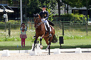 Fredrikke Dorati Bjerkasholmen - Scalas Scafero<br /> FEI European Championships Dressage Juniors and Young Riders 2012<br /> © DigiShots