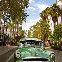 Hot rods cruise State Street in Santa Barbara.