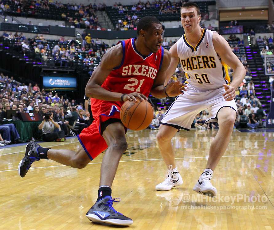 March 14, 2012; Indianapolis, IN, USA; Philadelphia 76ers forward Thaddeus Young (21) dribbles around Indiana Pacers power forward Tyler Hansbrough (50) at Bankers Life Fieldhouse. Mandatory credit: Michael Hickey-US PRESSWIRE