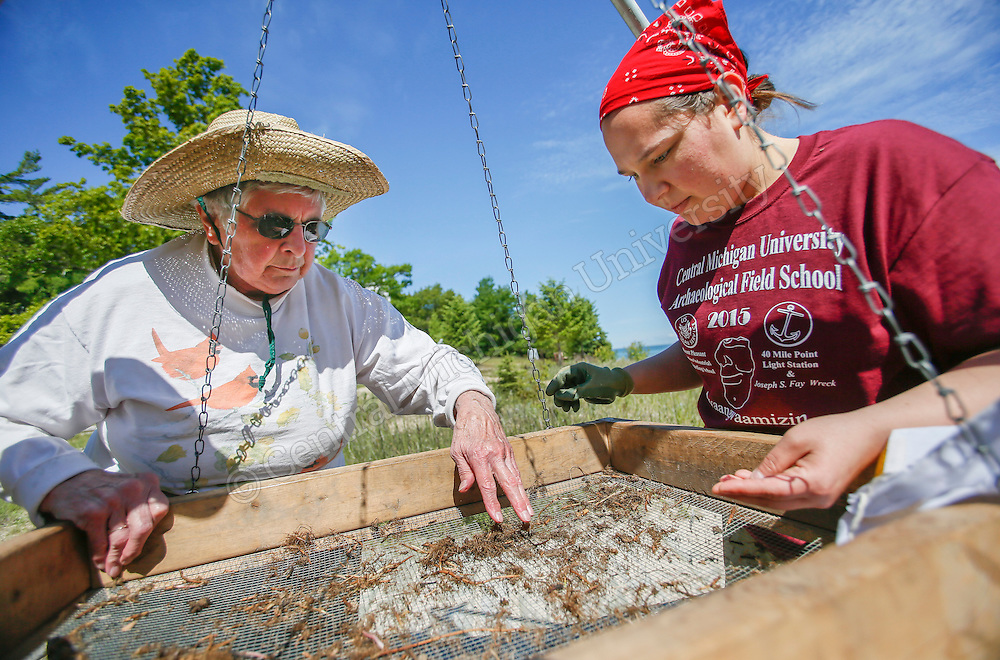 CMU anthropology students recently unearthed artifacts at the 40 Mile Point Lighthouse in Rogers City as part of the university's Archaeological Field School. Over the past six weeks, the field school has taught CMU students how to survey, excavate and analyze archaeological remains. Photo by Steve Jessmore/ Central Michigan University