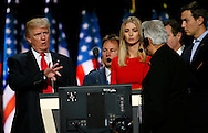 Republican presidential nominee Donald Trump talks to convention staff with daughter Ivanka (C) during Trump's walk through at the Republican National Convention in Cleveland July 21, 2016.  REUTERS/Rick Wilking