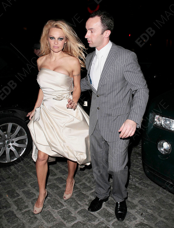 31.DECEMBER.2010. LONDON<br /> <br /> PAMELA ANDERSON ARRIVING BACK AT HER LONDON HOTEL LOOKING A LITTLE WORSE FOR WEAR AFTER SPENDING THE NEW YEARS EVE IN LONDON.<br /> <br /> BYLINE: EDBIMAGEARCHIVE.COM<br /> <br /> *THIS IMAGE IS STRICTLY FOR UK NEWSPAPERS AND MAGAZINES ONLY*<br /> *FOR WORLD WIDE SALES AND WEB USE PLEASE CONTACT EDBIMAGEARCHIVE - 0208 954 5968*