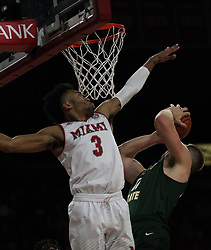 November 14, 2017 - Oxford, Ohio, U.S - Miami (Oh) Redhawks guard Jalen Adaway (3) block the shot of a Wright State Raiders player. During overtime play in Oxford,Ohio as the Redhawks win 73 to 67. (Credit Image: © Ernest Coleman via ZUMA Wire)