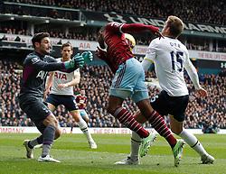 Tottenham Hotspur's Hugo Lloris West Ham's Diafra Sakho and Tottenham Hotspur's Eric Dier compete for the ball - Photo mandatory by-line: Mitchell Gunn/JMP - Mobile: 07966 386802 - 22/02/2015 - SPORT - football - London - White Hart Lane - Tottenham Hotspur v West Ham United - Barclays Premier League