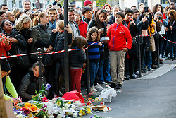 © Licensed to London News Pictures. 15/11/2015. Paris, France. Mourners visit Café Bonne Biére in Paris, France following the Paris terror attacks on Sunday, 15 November 2015. Photo credit: Tolga Akmen/LNP