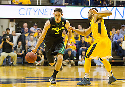 Feb 6, 2016; Morgantown, WV, USA; Baylor Bears guard Jake Lindsey (3) drives on West Virginia Mountaineers guard Jaysean Paige (5) during the first half at the WVU Coliseum. Mandatory Credit: Ben Queen-USA TODAY Sports