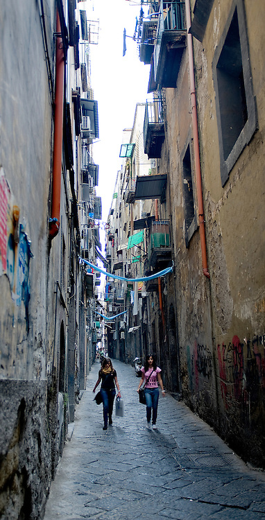 Young shoppers walk down one of the side streets in downtown Naples.