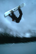 A snowboarder does an air in a half pipe in Stratton, Vermont.