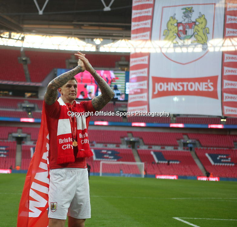 22 March 2015 - Johnstones Paint Trophy Final - Bristol City v Walsall - Aden Flint of City celebrates winning the JPT and applauds the fans.<br /> <br /> Photo: Ryan Smyth/Offside
