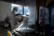 One of Ngam-nak's two full time cooks prepares the morning meal for the settlement's 110 students. Ngam-nak serves as a school for Tibetan nomadic children, who are dropped off by their parents and spend 8 months a year in the remote settlement until they have completed a basic level of education. Staffed by a handful of teachers and cooks, there are no other activities in Ngam-nak apart from the school.