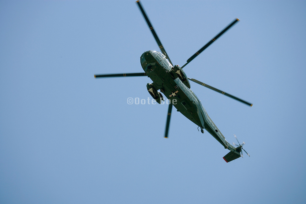 a US marine helicopter hovering against a blue sky