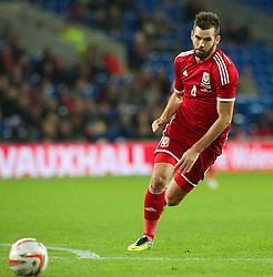 CARDIFF, WALES - Saturday, November 16, 2013: Wales' Joe Ledley in action against Finland during the International Friendly match at the Cardiff City Stadium. (Pic by David Rawcliffe/Propaganda)