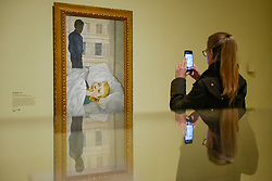 "© Licensed to London News Pictures. 23/10/2019. LONDON, UK. A visitor views ""Hotel Bedroom"", 1954, by Lucien Freud. Preview of ""Lucian Freud: The Self-portraits"" at the Royal Academy of Arts in Piccadilly.  56 works on display chart Freud's artistic development over almost seven decades on canvas and paper in a show which runs 27 October to 26 January 2020.  Photo credit: Stephen Chung/LNP"
