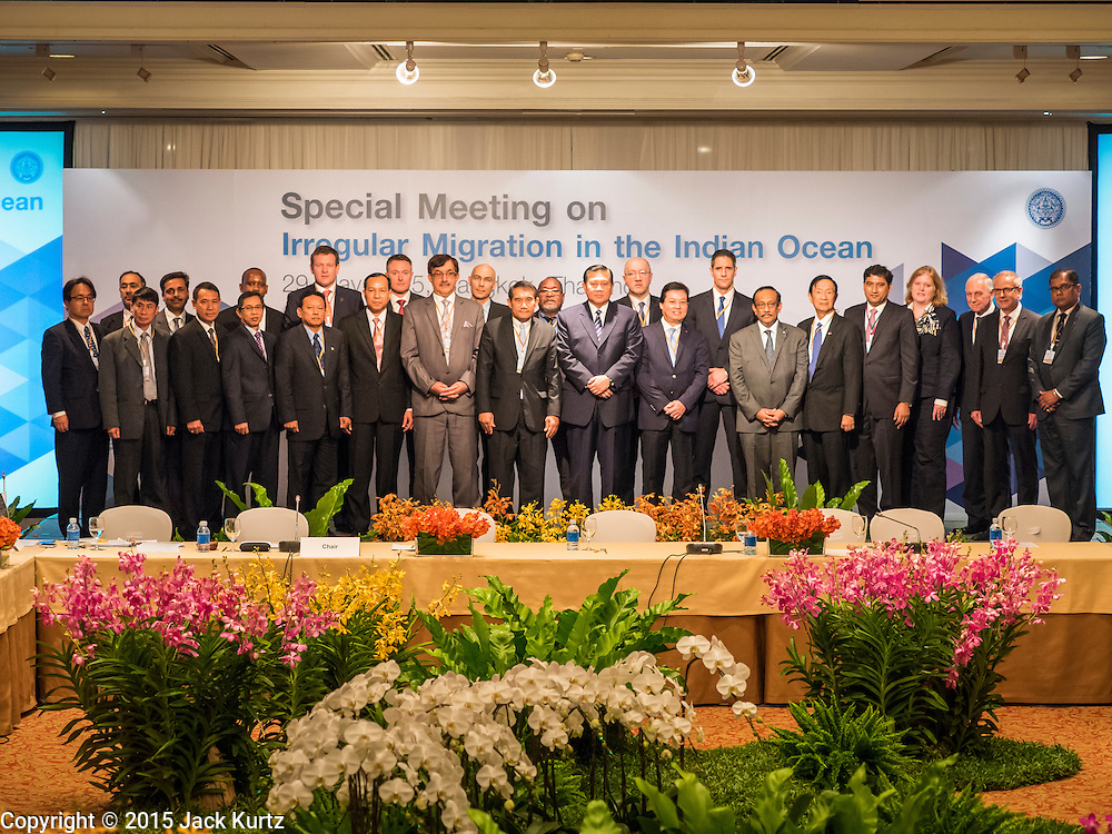 "29 MAY 2015 - BANGKOK, THAILAND:  Participants in the ""Special Meeting on Irregular Migration in the Indian Ocean"" gather for the ceremonial group photo at the opening of the meeting. Thailand organized and hosted the meeting at the Anantara Siam Hotel in Bangkok. The meeting brought together representatives from the 5 countries impacted by the boat people exodus: Thailand, Malaysia and Indonesia, which have all received boat people, and Myanmar (Burma) and Bangladesh, where they are coming from. Non-governmental organizations, like the International Organization for Migration (IOM) and UN High Commissioner for Refugees (UNHCR) as well as countries responding to the crisis, like the United States, also attended the meeting. A total of 22 organizations attended the one day conference.     PHOTO BY JACK KURTZ"
