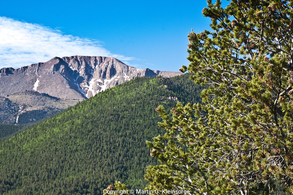The summit of 14,110 ft. Pikes Peak as viewed from along the Pikes Peak HWY.  Colorado.
