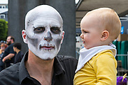 UNITED KINGDOM, London: 27 May 2018 Alex Glass, aged 11 months, looks perplexed at his father Andy Glass   at the MCM London Comic Con earlier today. The three day comic convention, which is held at London's ExCeL, was visited by thousands of avid cosplay fans and enthusiasts. Rick Findler / Story Picture Agency