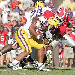 25 October 2008:  Georgia defensive tackle Kade Weston (91) tackles LSU running back Charles Scott (32) during the Georgia Bulldogs versus the LSU Tigers game at Tiger Stadium in Baton Rouge, LA.