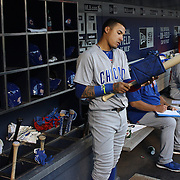 NEW YORK, NEW YORK - June 30: Javier Baez #9 of the Chicago Cubs in the dugout preparing to bat during the Chicago Cubs Vs New York Mets regular season MLB game at Citi Field on June 30, 2016 in New York City. (Photo by Tim Clayton/Corbis via Getty Images)