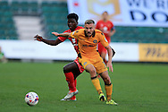 Dan Butler of Newport county holds off Kabongo Tshimanga of MK Dons. EFL cup, 1st round match, Newport county v Milton Keynes Dons at Rodney Parade in Newport, South Wales on Tuesday 9th August 2016.<br /> pic by Andrew Orchard, Andrew Orchard sports photography.
