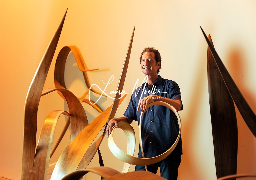 Charlotte Observer Only - Rick Lazes, whose studio is at the NC Music Factory, has been creating sculptures for more than 3 decades. His medium of choice is wood (walnut, cherry, maple, ash and poplar), which is steamed, and bent into organic forms.<br />     Several pieces from &lsquo;The World of Bending&rsquo; series are on exhibition for the first time at The Andre Christine Gallery &amp; Sculpture Garden in Mooresville.<br /> photo by Laura Mueller<br /> www.lauramuellerphotography.com