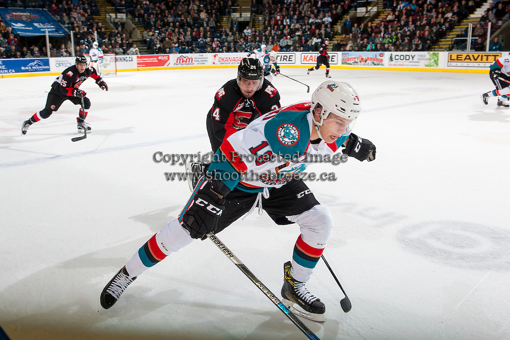 KELOWNA, CANADA - MARCH 1: Carsen Twarynski #18 of the Kelowna Rockets skates as Radovan Bondra #24 of the Prince George Cougars stick checks on MARCH 1, 2017 at Prospera Place in Kelowna, British Columbia, Canada.  (Photo by Marissa Baecker/Shoot the Breeze)  *** Local Caption ***