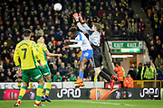 Norwich City goalkeeper Michael McGovern (33) claims this cross in front of Portsmouth forward Jamal Lowe (10) during the The FA Cup 3rd round match between Norwich City and Portsmouth at Carrow Road, Norwich, England on 5 January 2019.