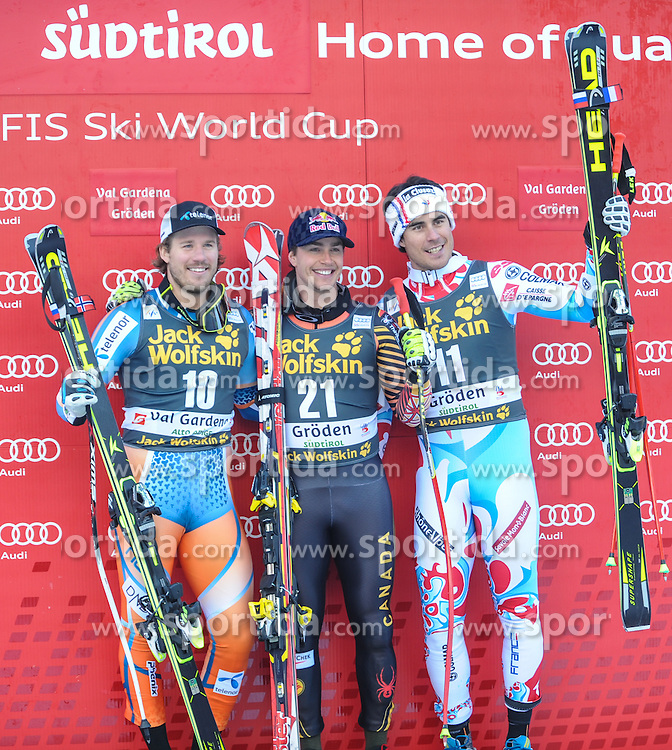 21.12.2013, Saslong, Groeden, ITA, FIS Ski Weltcup, Groeden, Riesentorlauf, Herren, Siegerpraesentation, im Bild v.l.n.r. Kjetil Jansrud (NOR, 2. Platz) , Erik Guay (CAN, 1. Platz) , Johan Clarey (FRA, 3. Platz) // f.l.t.r. 2nd place Kjetil Jansrud of Norway, 1st place Erik Guay of Canada and 3rd place Johan Clarey of France Celebrate on Podium after mens Giant Slalom of the Groeden FIS Ski Alpine World Cup at the Saslong Raptor in Groeden, Italy on 2012/12/21. EXPA Pictures © 2013, PhotoCredit: EXPA/ Erich Spiess