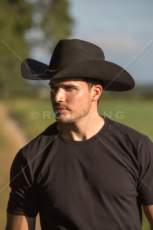 Handsome cowboy outdoors