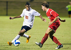 Virginia Cavaliers defender Shawn Barry (21) squares against St. John's Red Storm midfielder Pablo Punyed (15).  The Virginia Cavaliers fell to the St. John's Red Storm 1-0  in NCAA men's soccer at Klockner Stadium on the Grounds of the University of Virginia in Charlottesville, VA on August 29, 2008.