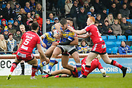 Tom Briscoe of Leeds Rhinos on the attack against Nial Evalds (L) and Josh Jones (R) of Salford Red Devils during the Betfred Super League match at Emerald Headingley Stadium, Leeds<br /> Picture by Stephen Gaunt/Focus Images Ltd +447904 833202<br /> 02/04/2018