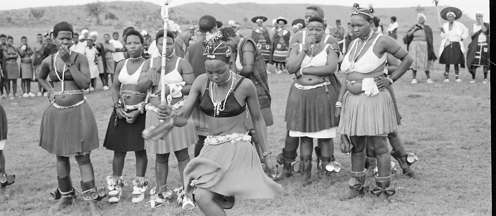 Msinga Top, Msinga, KwaZulu Natal, South Africa, December 1998. A dance group in Msinga, KwaZulu-Natal prepare to perform at a young girl's coming of age, or memulo, KwaZulu-Natal, South Africa